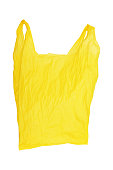 one open wrinkled yellow plastic bag isolated on white.