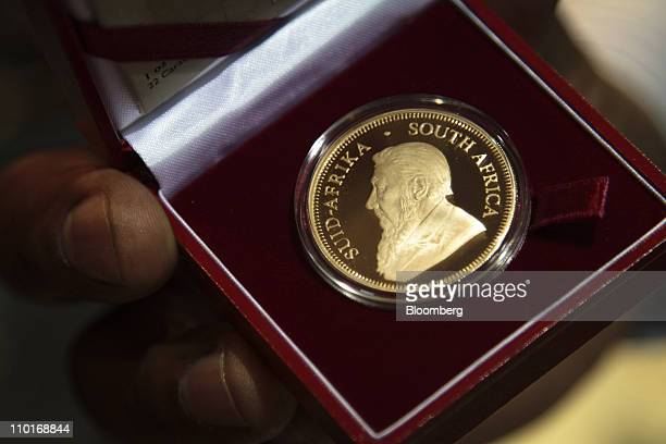A one ounce 22 carat gold krugerrand coin sits in a display case at the South African Mint Company in Pretoria South Africa on Tuesday March 15 2011...