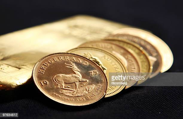 A one ounce gold krugerrand sits alongside gold coins at Goldcore Ltd in London UK on Thursday March 11 2010 Gold futures gained 24 percent last year...