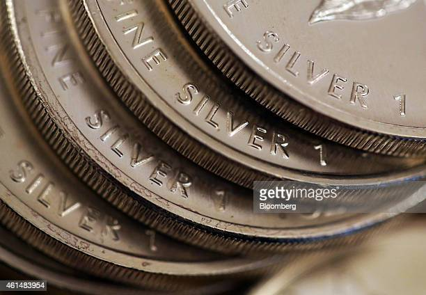One ounce silver coins are seen in this arranged photograph taken at Gold Investments Ltd bullion dealers in London UK on Tuesday Jan 13 2015 Gold...