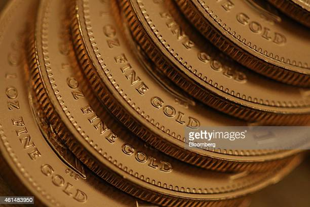 One ounce South African gold coins are seen in this arranged photograph taken at Gold Investments Ltd bullion dealers in London UK on Tuesday Jan 13...
