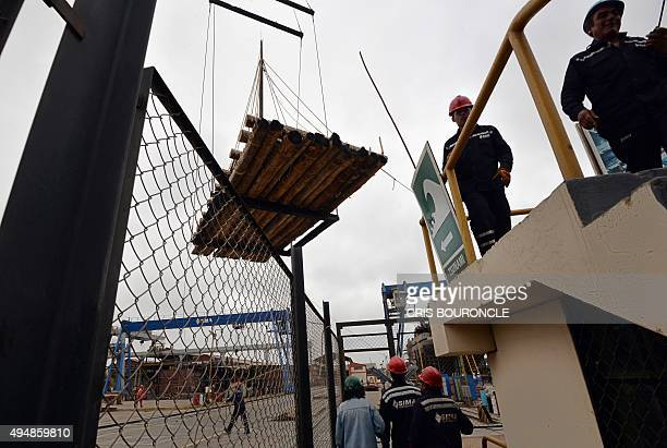 One out of two 23ton rafts made mostly of balsa wood is lifted by a crane at the Industrial Services sector of the Peruvian Navy at the port of...
