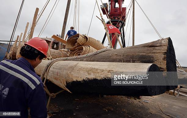 One out of two 23ton rafts made mostly of balsa wood is prepared to be lifted by a crane at the Industrial Services sector of the Peruvian Navy at...