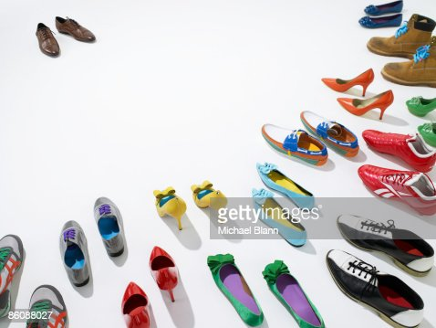 One pair of shoes facing other pairs : Foto de stock