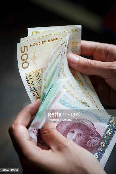 One person holds Norwegian kroner the currency of the Kingdom of Norway in the hands on July 13 2015 in Ulvik Norway