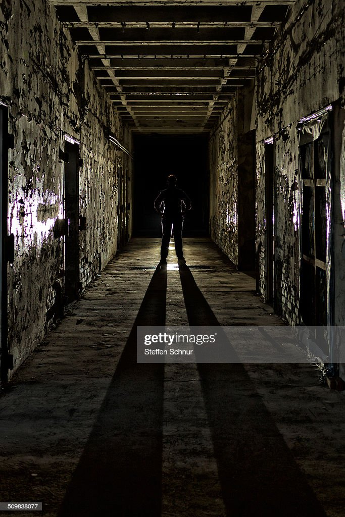 One Person In A Dark Hallway : Stock Photo