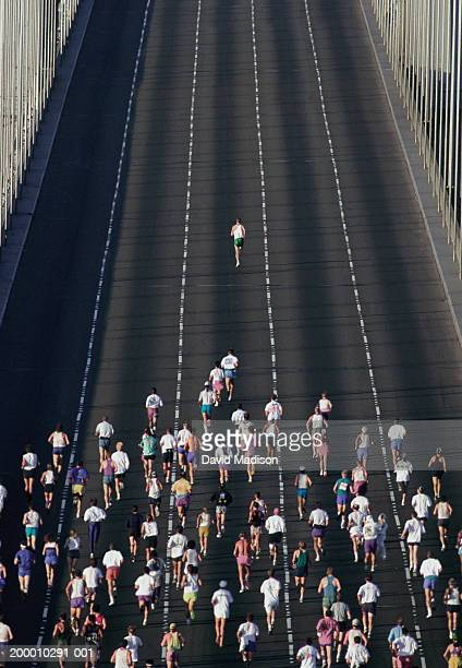 One person leading marathon over bridge (overhead view)