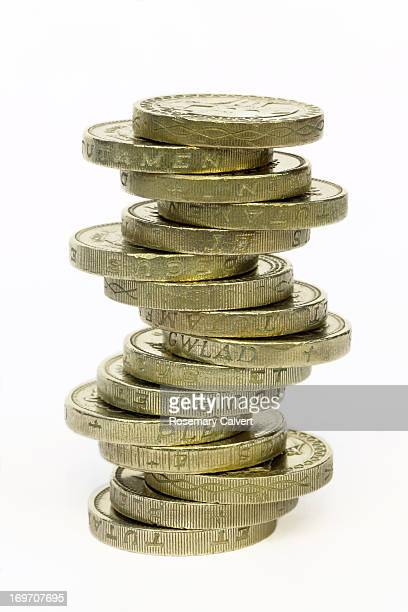 One pound coins balanced in stack