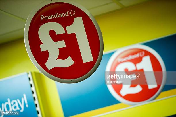 A one pound sterling sign hangs from the ceiling at a Poundland Group Plc store in Leigh UK on Thursday Feb 4 2016 UK like for like sales at...
