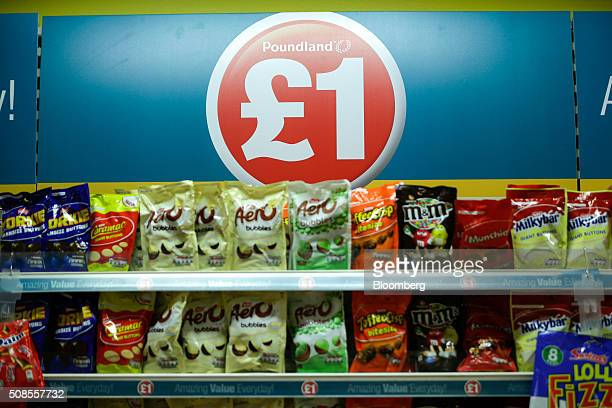 A one pound sterling sign sits above chocolate snacks at Poundland Group Plc store in Leigh UK on Thursday Feb 4 2016 UK like for like sales at...