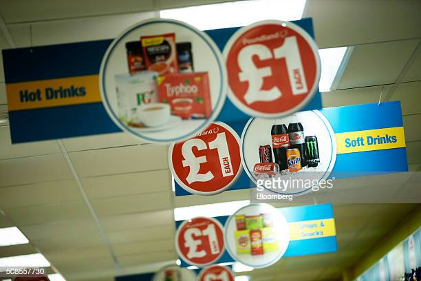 One pound sterling signs hang from the ceiling at a Poundland Group Plc store in Leigh UK on Thursday Feb 4 2016 UK like for like sales at midmarket...