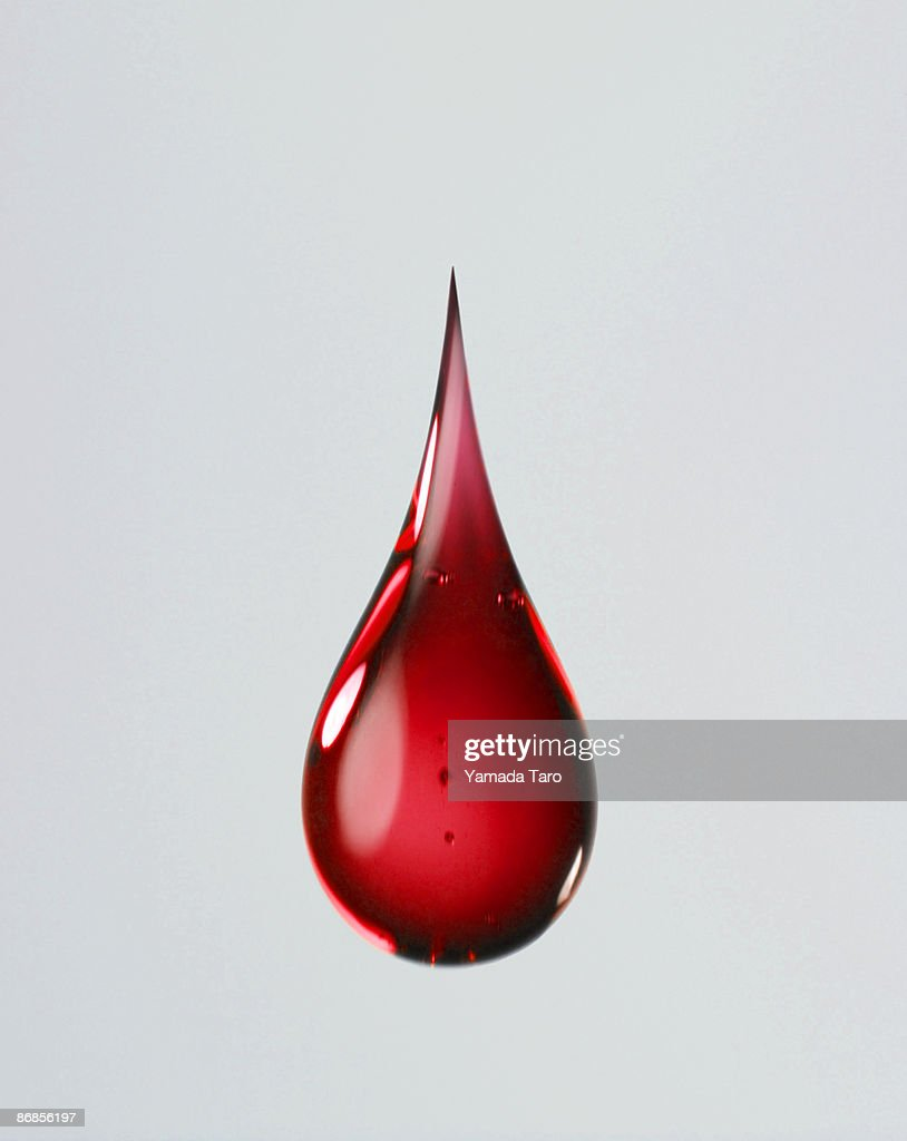 One red drop on grey background : Stock Photo