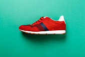 one red sneaker on a bright contrasting background. place for text