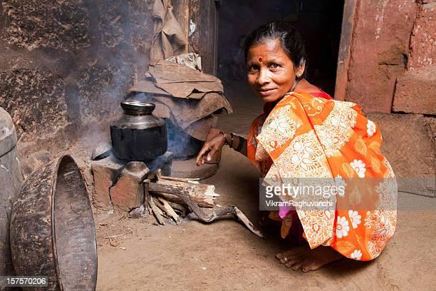 One Rural Indian Female Woman preparing food Horizontal