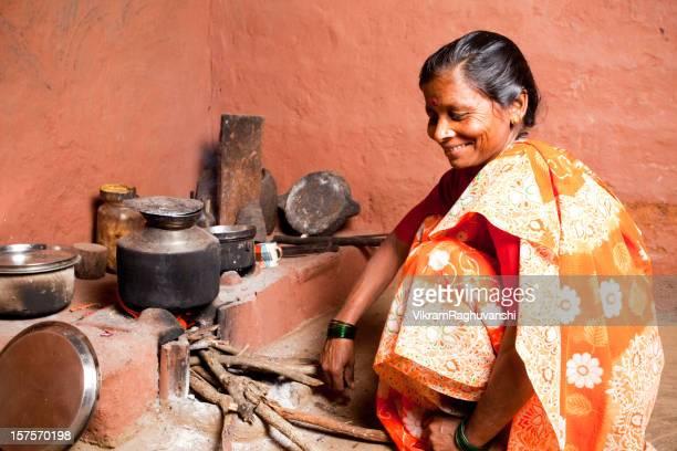 One Rural Indian Female Woman preparing food