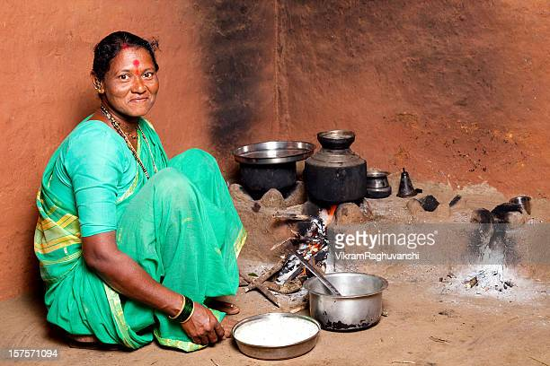 One Rural Indian Woman cooking food in the Kitchen