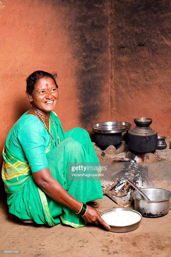 http://media.gettyimages.com/photos/one-rural-indian-woman-cooking-food-in-the-kitchen-picture-id157571107 Indian Woman Cooking