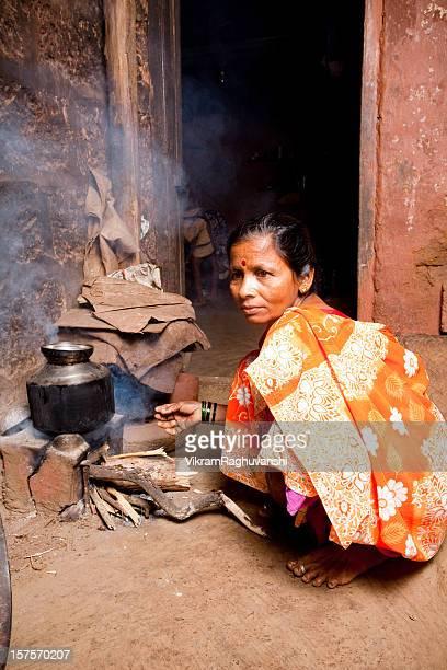 One Rural Indian Woman Female preparing food Vertical