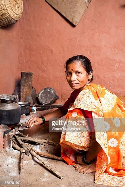 One Rural Indian Woman preparing food