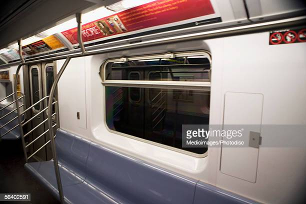 One side of the interior of a subway car