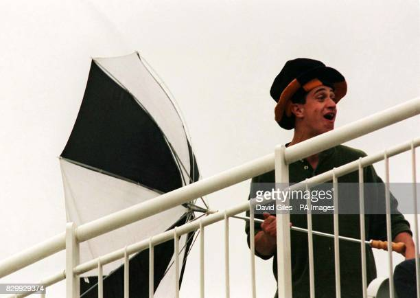 One spectator battles against the elements at Lords today as rain filled clouds and blustery winds continue to prevent play on the opening day of the...