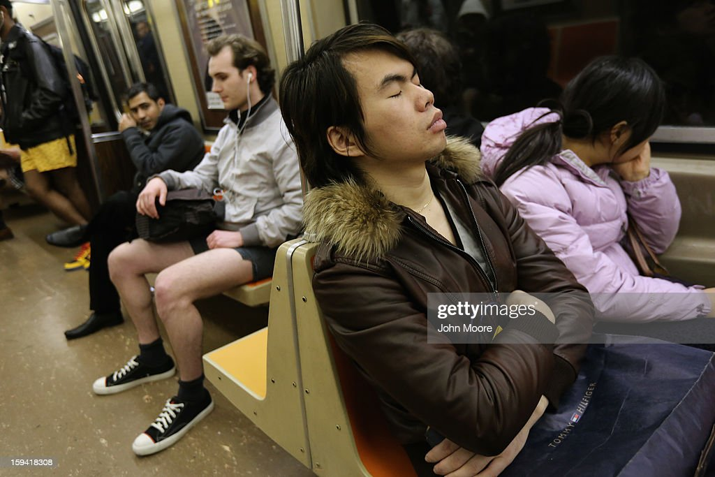 One subway passenger sleeps as others ride the train pantless on January 13, 2013 in New York City. Thousands of people participated in the 12th annual No Pants Subway Ride, organized by New York City prank collective Improv Everywhere. During the afternoon winter event, participants boarded separate subway stops and removed their pants, pretending that they did not know each other. The event, refered to as a 'celebration of silliness' is designed to make fellow subway riders laugh and smile.
