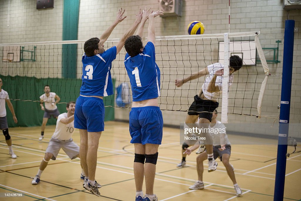 One team scoring a point in a game of Volleyball. : Stock Photo