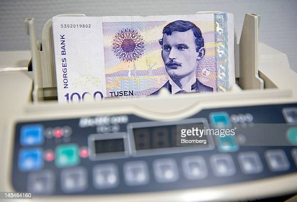 One thousand krone Norwegian bank notes sit in a moneycounting machine at a Forex currency exchange center in Oslo Norway on Thursday April 26 2012...