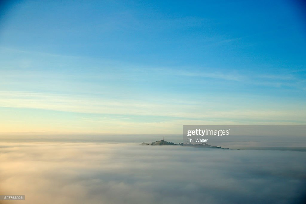 One Tree Hill struggles to break through a blanket of fog over Auckland City on May 4, 2016 in Auckland, New Zealand. The morning fog disrupted flights and ferry services in the city.