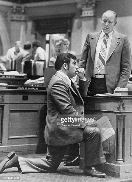 MAR 16 1977 MAR 17 1977 One Vote for One Against Bill on Bilingual Education Rep Ruben Valdez DDenver the House minority leader kneels during a...
