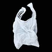 it is one white plastic bag isolated on black.