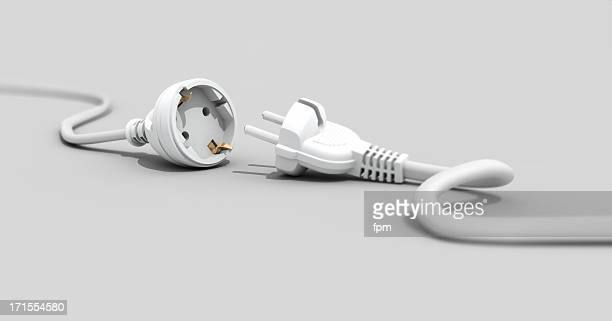 One white plug unplugged from another white plug