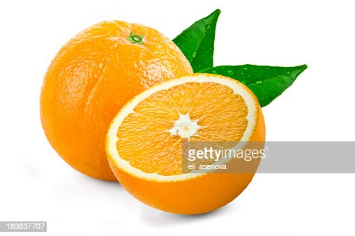 One whole and a sliced half of an orange with green leaves