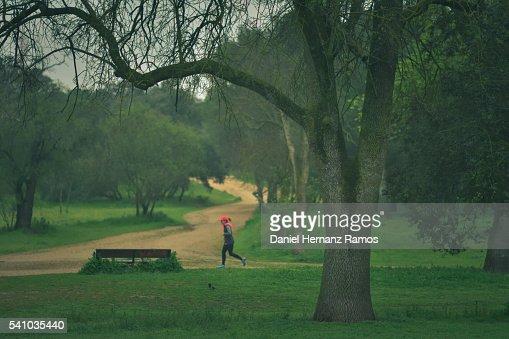 One woman running in a famous madrid park casa de campo - Casa de campo park ...