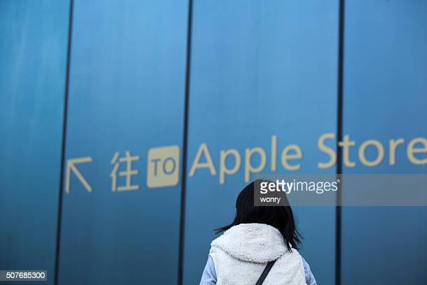 One woman watch road sign of apple store