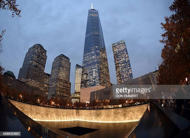 One World Trade Center raises high above a reflecting pool November 13 2014 in New York Patrick Foye Executive Director of the Port Authority of New...