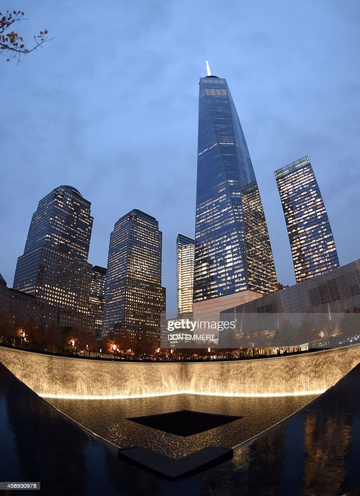 One world trade center raises high above a reflecting pool for Pool trade show new york