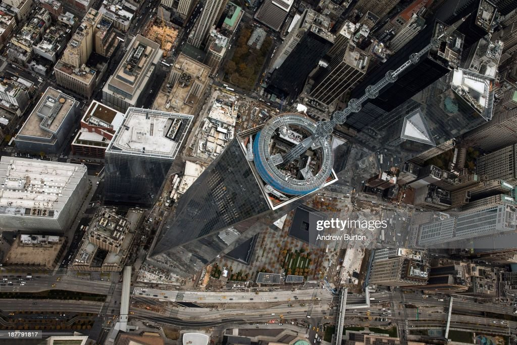 One World Trade Center, seen from a helicopter looking directly down on the building on November 12, 2013 in New York City. The building was deemed the tallest building in North America today; the title was previously held by Willis Tower in Chicago (previously titled Sears Tower).