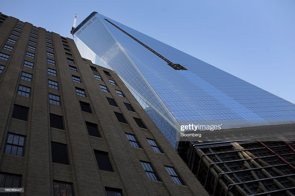 One World Trade Center stands in New York, U.S., on Tuesday, April 2, 2013. The observation deck at One World Trade Center, expected to open in 2015, will occupy the tower's 100th through 102nd floors. Guests visiting the observation deck will see a 'pre-show' about the creation of the building while waiting in line in the lobby. Photographer: Victor J. Blue/Bloomberg via Getty Images