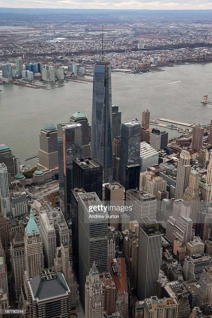One World Trade Center towers over lower Manhattan on November 12, 2013 in New York City. The building was deemed the tallest building in North America today; the title was previously held by Willis Tower in Chicago (previously titled Sears Tower).