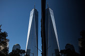 One World Trade Center which opens today is reflected in a window on November 3 2014 in New York City The skyscraper is 104 stories tall and cost $39...