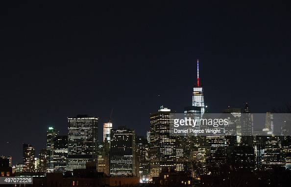 One World Trade Center's spire is shown lit in French flags colors of white blue and red in solidarity with France after tonight's terror attacks in...