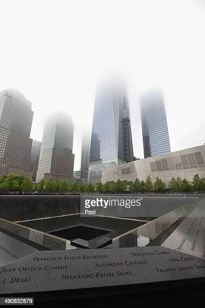 One World Trade rises through the fog over the memorial plaza during the dedication ceremony for the museum at ground zero May 15 2014 in New York...