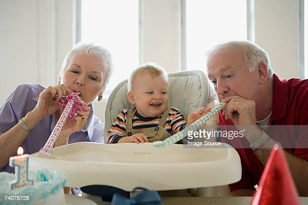 One year old with grandparents