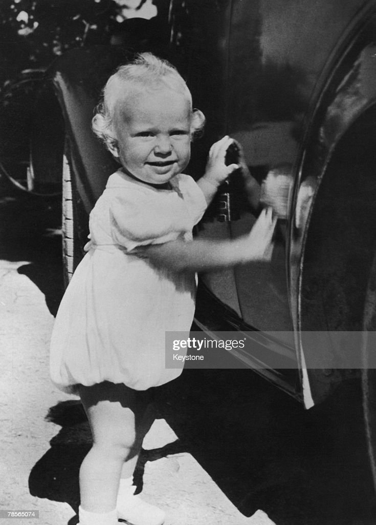 One year-old Prince Carl Gustaf Folke Hubertus of Sweden (later King <a gi-track='captionPersonalityLinkClicked' href=/galleries/search?phrase=Carl+XVI+Gustaf&family=editorial&specificpeople=159449 ng-click='$event.stopPropagation()'>Carl XVI Gustaf</a> of Sweden) visiting his great-grandfather, King Gustav V, at Solliden Palace on the island of Oeland, Sweden, 20th August 1947.