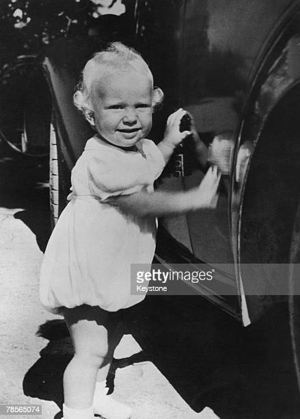 One yearold Prince Carl Gustaf Folke Hubertus of Sweden visiting his greatgrandfather King Gustav V at Solliden Palace on the island of Oeland Sweden...