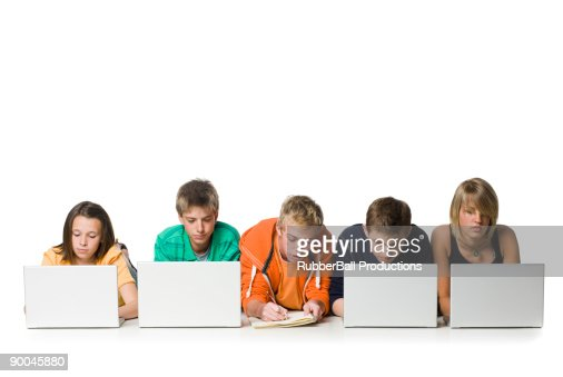 one young man writing amid others on laptops : Stock-Foto