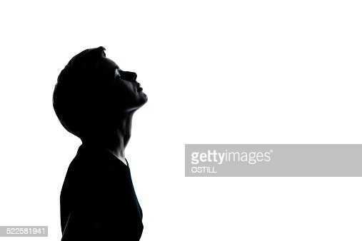 one young teenager boy or girl looking up silhouette stock