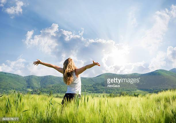 One young woman Feeling free outdoor in the wheat field
