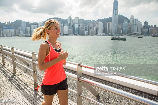 One young woman joggin in Hong Kong